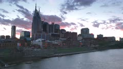 sunset view of the city from shelby street pedestrian bridge over the cumberland river in nashville, tennesse