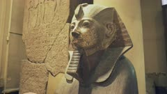 close up of a stone statue of a pharaoh in cairo, egypt