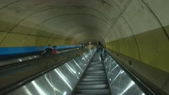 riding a long subway escalator at woodley park metro station in washington dc