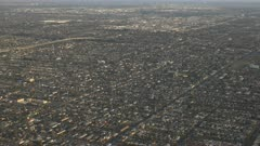 an afternoon aerial view of los angeles looking west from an airplane in california, usa
