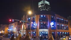 a night time three axis gimbal shot crossing the main street, broadway, in nashville, tennessee
