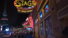 night time three axis gimbal shot walking towards neon signs on broadway in nashville, tennessee