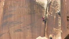 a woman falls while rock climbing at canyonlands national park in utah, usa