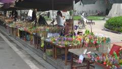 vietnamese women selling artificial flowers and toys at a market near hoan kiem lake in hanoi, vietnam
