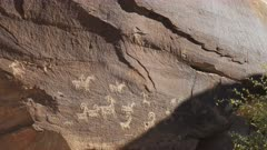 wide view of indian art on a rock face near wolfe ranch at arches national park in utah, usa