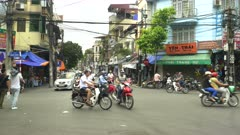 morning traffic at a busy intersection in the old quarter of hanoi, vietnam