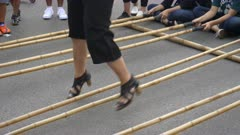 close up of the feet of a woman performing the tinikling dance in hanoi, vietnam