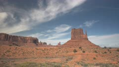 panning shot of west mitten and sentinel mesa at monument valley in utah, usa