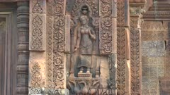 close up of hindu diety statues at banteay srei temple in angkor, cambodia
