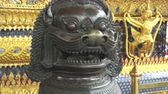 close up of a bronze chinese lion statue at wat phra kaew temple in bangkok, thailand