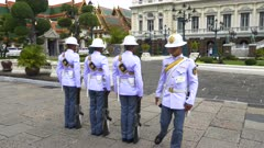 guards changing duty at the grand palace in bangkok, thailand