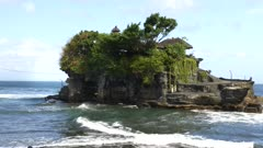 close up of pura tanah lot temple at high tide on the indonesian island of bali