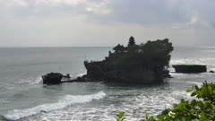high angle afternoon view of tanah lot temple on the indonesian island of bali