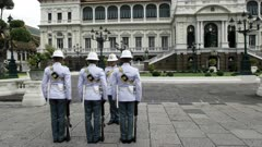 rear view of palace guards changing duty at the grand palace in bangkok, thailand