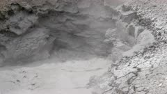 close up of the boiling water of mud volcano at hayden valley in yellowstone national park, usa