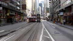 close up of an historic double-decker tram approaching in downtown hong kong, china