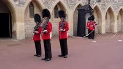 the changing of the queen's guard at windsor castle, england