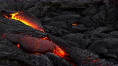 a close up tilt down shot of a surface lava flow from kilauea volcano on the big island of hawaii in the united states of america