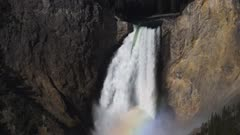 a slow motion close up of lower falls and its rainbow at yellowstone national park, usa