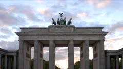 a sunset zoom in shot of the brandenburg gate in berlin, germany