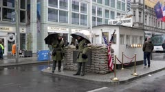 the famous checkpoint charlie in berlin, germany on a rainy autumn day