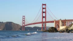 a close view of golden gate bridge from marshall's beach in san francisco, california