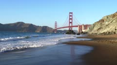 a gimbal steadicam shot walking along marshall beach with san francisco's golden gate bridge in the background