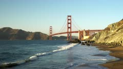a wide angle shot of golden gate bridge from marshall beach in san francisco