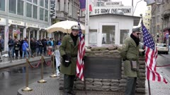 two mock american sentries at checkpoint charlie in berlin, germany