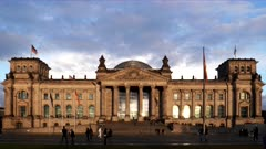 a sunset view of the front exterior of the reichstag building in berlin, germany