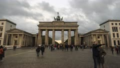 a time lapse of tourists at the brandenberg gate in berlin, germany on a cloudy autumn afternoon