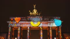 a night shot of brandenburg gate with love hearts projected onto it in berlin, germany