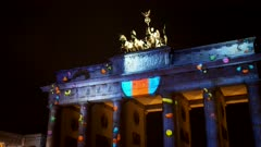 side view of berlin's brandenburg gate with love hearts projected onto it during the festival of lights