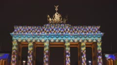 psychedelic looking lights projected onto brandenburg gate in berlin, germany for the 2017 festival of lights