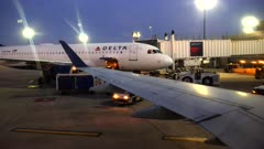 an early morning shot of two delta airplanes at a gate at boston airport
