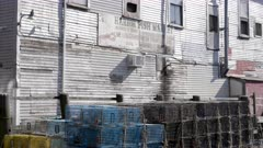 close up view of lobster traps and a warehouse at portland in maine, usa