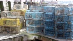 close up panning shot of lobster traps on a wharf in portland, maine