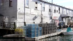 lobster traps and warehouses on the waterfront of portland in maine, usa