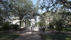 a gimbal shot walking towards the james oglethorpe statue in chippewa square at savannah, georgia