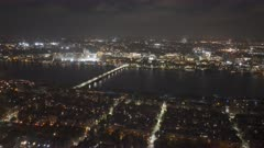 night pan of boston's charles river in the direction of MIT from the observation deck of skywalk in boston, massachusetts