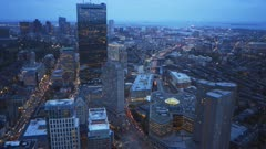 an evening view of the financial district of boston from the observation deck of skywalk in boston, massachusetts
