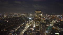 a night panning shot of the financial district of boston from the observation deck of skywalk in boston, massachusetts