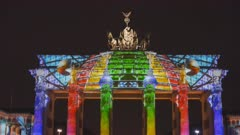 a zoom in clip of brandenburg gate during a lights festival in germany