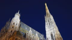 an ultra wide night shot of st stephen's cathedral in vienna, austria