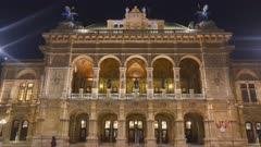 close up night shot of the exterior of the state opera house in vienna, austria