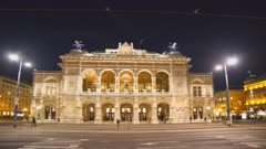 an ultra wide angle night shot of the state opera house in vienna, austria