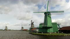 three windmills at the historic village of zaanse schans near amsterdam, netherlands