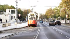 close up of two electric trams on a street of vienna, austria