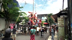 bamboo poles used to move power lines near an ogoh-ogoh statue in kuta, bali