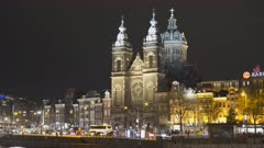 a night shot of basilica st nicholas in amsterdam, netherlands